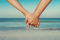 Lovers couple holding hands Royalty Free Stock Photos