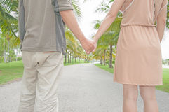 Lovers couple holding hands Royalty Free Stock Images