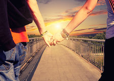 Lovers couple holding hands Stock Images