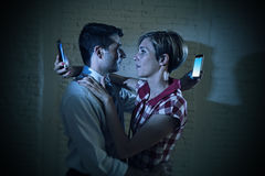 Lovers couple of internet and mobile phone addict ignoring each other Stock Photos