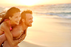Lovers couple in love having fun on beach portrait Stock Photos