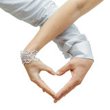 Lovers couple making a heart with hands Stock Images