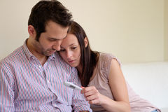 Lovers couple scared after pregnancy test. Result Stock Photography