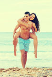 Lovers couple at sea shore Royalty Free Stock Images