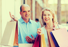 Lovers couple after shopping tour outdoor smiling. Together Royalty Free Stock Photos