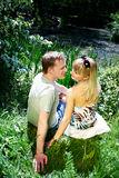 Lovers couple on the shore of the pond Royalty Free Stock Photos