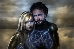 Lovers, couple of super heroes of the future, desert landscape Stock Image