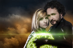 Lovers, couple of super heroes of the future, green shield over Stock Photography