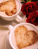 Lovers' cups. Lovers' cups with two roses aside stock photography