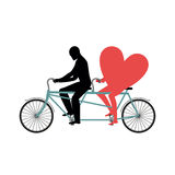 Lovers of cycling. Man rolls heart on tandem. Heart symbol of lo Stock Photos