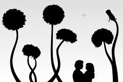 Lovers and dandelions Stock Photos