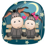 Lovers Donkeys. Valentine card with Lovers Donkeys on the swing Stock Photos