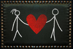 Lovers drawn on the leather pattern with knobs Stock Images