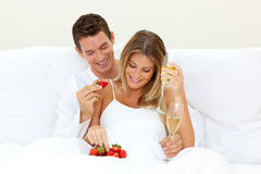 Lovers drinking Champagne with strawberries Royalty Free Stock Photo