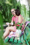 Lovers Drinking Tea on Bench stock images