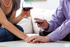 Lovers drinking wine. A closeup of lovers drinking a glass of red wine stock images