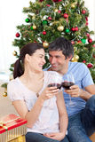Lovers drinking wine at homa at Christmas time Stock Photo