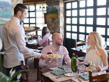 Lovers eating salads in restaurant Stock Images