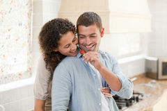 Lovers eating a strawberry in their kitchen Royalty Free Stock Photo