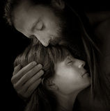 The Lovers Embrace. Beautiful artistic Image of two lovers on black Stock Image