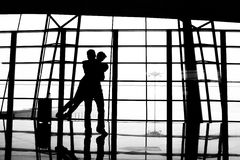 Lovers embrace. In the airport Stock Photography