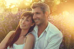 Lovers embracing eachother. Sunset couple relaxing in the color of spring royalty free stock photos
