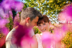 Lovers embracing eachother. Sunset couple relaxing in the color of spring stock images