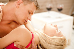 Lovers enjoying in bed Stock Photo