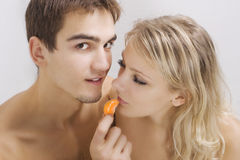 Lovers enjoying fruit breakfast in bed Stock Photography
