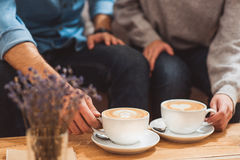 Lovers enjoying hot beverage on date Stock Image