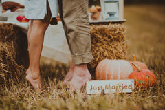 Lovers feet on the field of hay Royalty Free Stock Photography