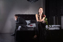 Lovers Fighting for Something While at the Bedroom Royalty Free Stock Photography