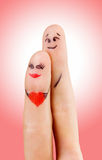 Lovers fingers. A happy couple in love with painted smiley and hugging Stock Photos
