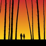 Lovers in forest at sunset. Vector illustration with silhouette of loving couple under evening sky. Bright gradient background Stock Images