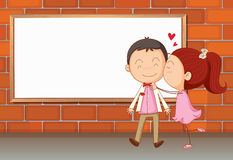Lovers in front of an empty wooden board Stock Images