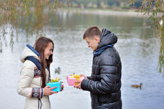 Lovers give each other a gift Stock Image