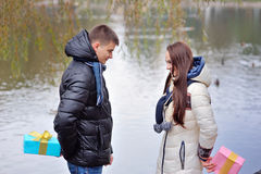 Lovers give each other a gift on Valentine's Day Royalty Free Stock Photography