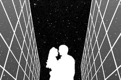 Lovers between glass buildings at night Royalty Free Stock Images