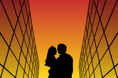 Lovers between glass buildings at sunset. Vector illustration with silhouette of loving couple. Bright gradient background stock illustration
