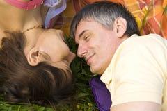 Lovers on grass Stock Photos