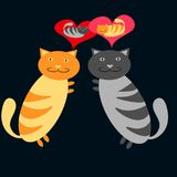Lovers of a gray cat and a red cat embrace each other and think about each other on a dark blue background. Royalty Free Stock Image