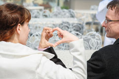 Lovers hands make in heart shape by hand Stock Photo
