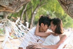 Lovers are happy in the embrace and smile in the beautiful beach.  Royalty Free Stock Photo