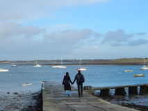 romantic Lovers walking at the pier Royalty Free Stock Photo