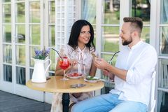 Lovers have lunch in a cafe. A man and a woman have just started dating, go to restaurants, walk, spend time together. Lovers have lunch in a cafe. A men and a stock images