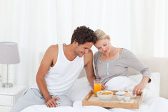 Lovers having breakfast at bed Stock Photography