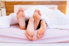 Lovers having sex. Under blanket stock photos