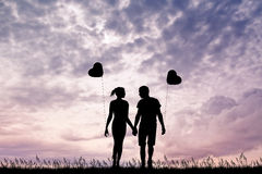 Lovers with heart balloons Stock Photography