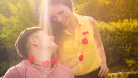 Lovers with hearts outdoor Stock Images
