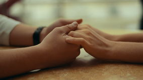 Lovers holding each other's hands stock footage